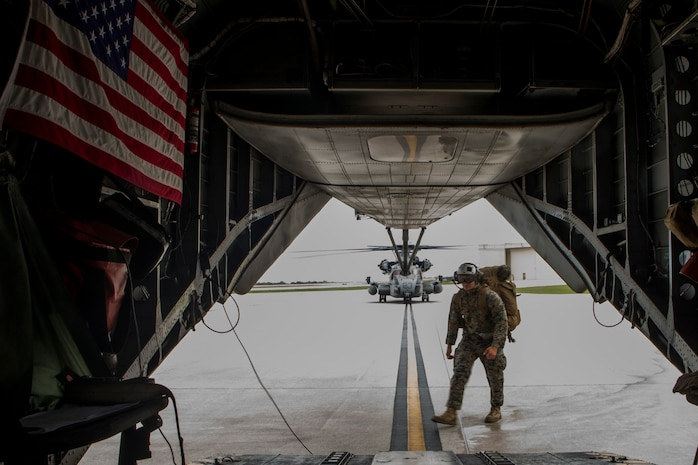 Cpl. Joseph Apodaca, a radio operator with Combat Logistics Battalion 31, carries gear onto a CH-53E Super Stallion with Marine Medium Tiltrotor Squadron 262 (Rein.) at Andersen Air Force Base as part of typhoon relief efforts in Rota, Northern Mariana Islands, Sept. 11, 2018. Apodaca, a native of Casa Grande, Arizona, graduated Vista Grande High School May 2013; he enlisted in the Marine Corps Aug. the same year. Service members from the Indo-Pacific Command are providing Department of Defense support to the Federal Emergency Management Agency, and working with Guam and Commonwealth of the Northern Marianas civil and local officials for Typhoon Mangkhut recovery efforts. The 31st Marine Expeditionary Unit, the Marine Corps' only continuously forward-deployed MEU, provides a flexible force ready to perform a wide-range of military operations.