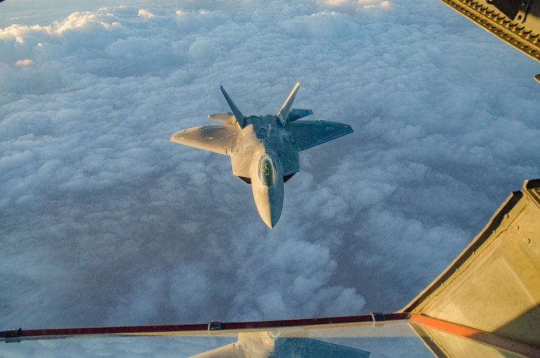 An F-22 aligns with a KC-10 over the skies of Southwest Asia.