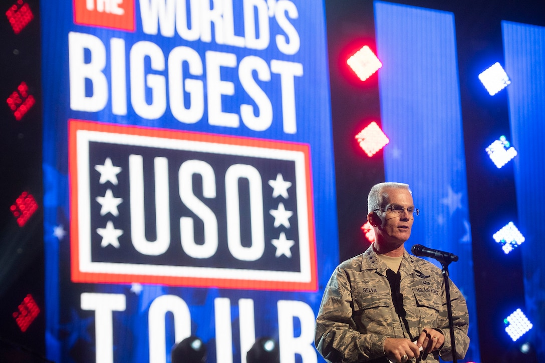 Air Force Gen. Paul J. Selva, vice chairman of the Joint Chiefs of Staff, addresses service members from a stage.