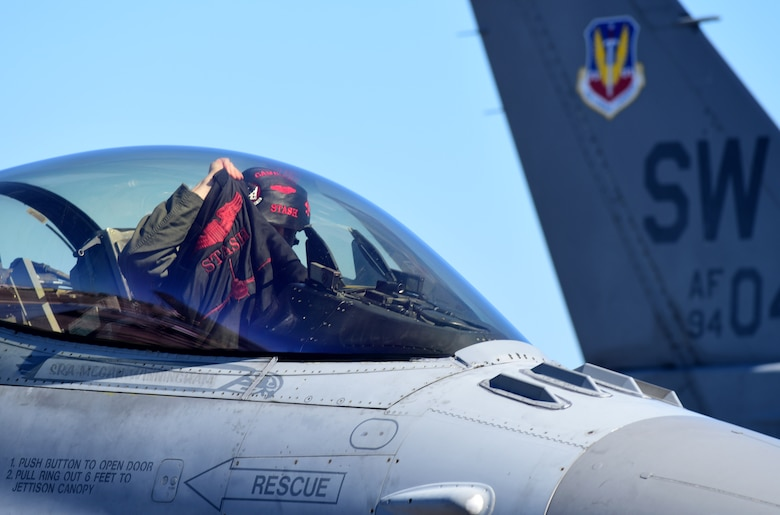 A U.S. Air Force F-16 Fighting Falcon pilot from the 20th Fighter Wing, S.C., prepares to disembark the aircraft after landing at Tyndall Air Force Base, Fla., Sept. 12, 2018. Shaw sent its 77th and 79th Fighter Squadron aircraft to Tyndall to escape the path of Hurricane Florence. (U.S. Air Force photo by Senior Airman Isaiah J. Soliz)