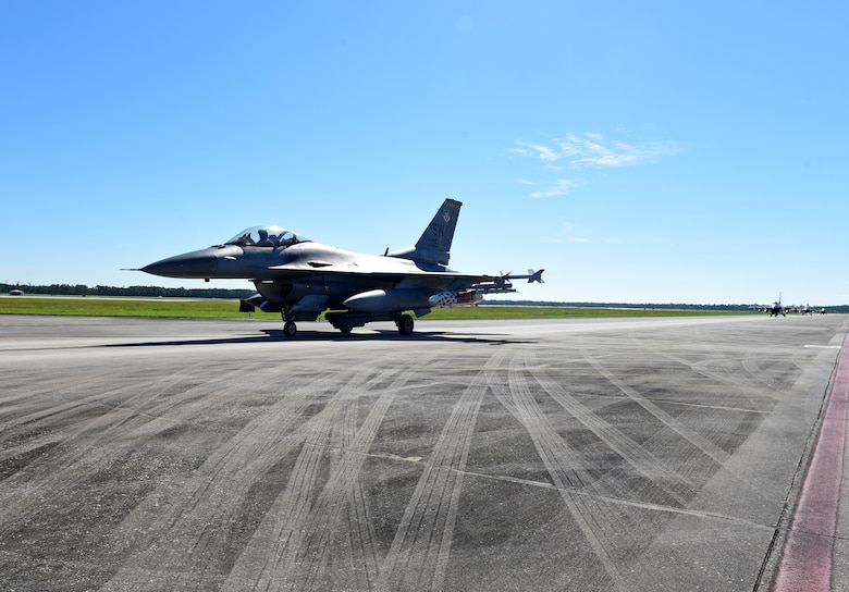 U.S. Air Force F-16 Fighting Falcons from the 20th Fighter Wing, Shaw Air Force Base, S.C., taxi on the flightline at Tyndall Air Force Base, Fla., Sept. 12, 2018. Shaw sent aircraft from both the 77th and the 79th Fighter Squadrons to Tyndall to escape the path of Hurricane Florence. (U.S. Air Force photo by Senior Airman Isaiah J. Soliz)