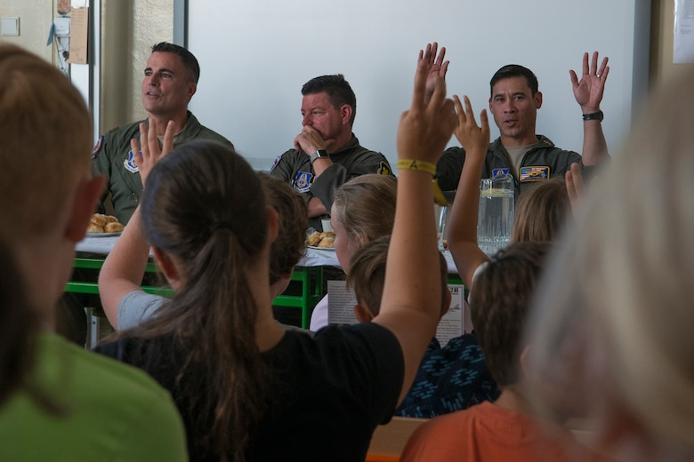 A U.S. Air Force Reserve aircrew assigned to the 307th Bomb Wing at Barksdale Air Force Base, La., answer questions from students at the General Zdenek Skarvada elementary school on Sept. 12, 2018, Ostrava, Czech Republic. The Airmen in Ostrava to support the NATO Days airshow and to communicate to U.S. and European partners defense and promote regional interoperability, security, and relations. (U.S. Air Force photo by Master Sgt. Greg Steele)