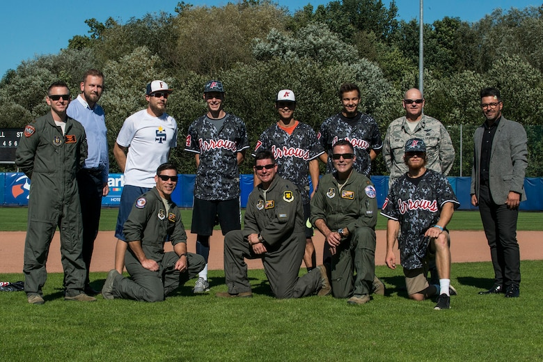 A U.S. Air Force Reserve aircrew assigned to the 307th Bomb Wing at Barksdale Air Force Base, La., takes a photo with players from the Arrows Baseball Club on Sept. 12, 2018, Ostrava, Czech Republic. The Airmen are in Ostrava to support the NATO Days airshow, which consists of the presentation of heavy military hardware, police and rescue equipment, dynamic displays of Special Forces training, flying displays, and presentation of armaments, equipment and military gear. (U.S. Air Force photo by Master Sgt. Greg Steele)