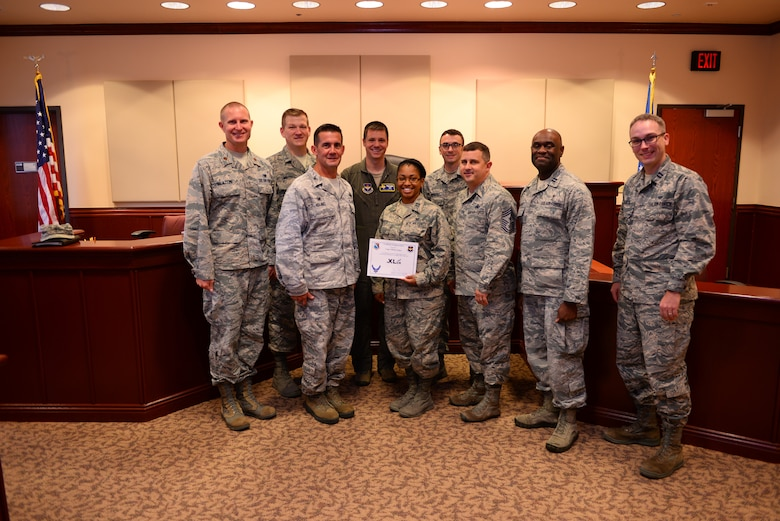 "Capt. Tiffany Sykes, 47th Flying Training Wing assistant staff judge advocate, was chosen by wing leadership to be the ""XLer"" of the week, for the week of Sept. 4, 2018, at Laughlin Air Force Base, Texas. The ""XLer"" award, presented by Col. Charlie Velino, 47th Flying Training Wing commander, is given to those who consistently make outstanding contributions to their unit and the Laughlin mission. (U.S. Air Force photo by Senior Airman Benjamin N. Valmoja)"