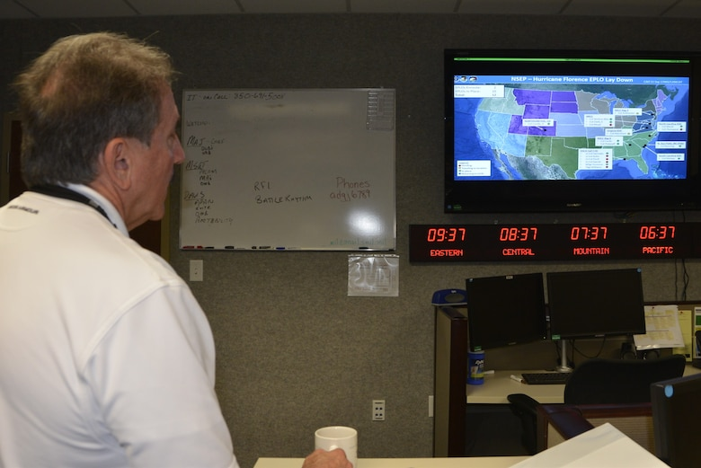 Rodney Simmons, Air Forces Northern National Security Emergency Preparedness Director, receives a briefing about the status of Emergency Preparedness Liaison Officers deployed ahead of Hurricane Florence landfall on the U.S. southeastern coast. Deploying EPLOs is one of the ways the Air Forces Northern enterprise assists U.S. Northern Command's support of the Federal Emergency Management Agency's response efforts for Hurricane Florence. (Air Force photo by Mary McHale)