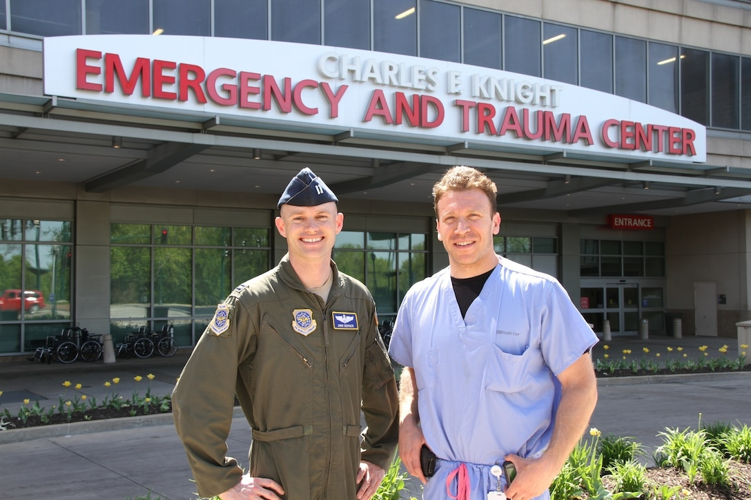 Lt. Col. John Berger and Dr. Scott Farber stand outside the Barnes-Jewish Hospital Emergency Department in St. Louis, Mo. Dr. Farber was part of the trauma team who saved Berger's life after he was hit by a truck in 2012. (Courtesy Photo)