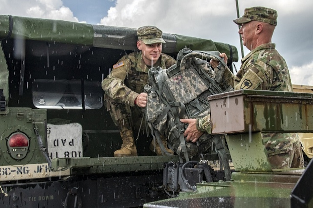Ahead of Hurricane Florence, South Carolina Army National Guard members load gear into a Humvee in Eastover, S.C.