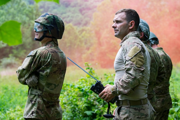 Operations Group Airmen prepare to be evacuated while participating in Survival, Evasion, Resistance and Escape (SERE) training June 2, 2018 at Alum Creek, W.Va.The Airmen completed a refresher version of the original SERE course, which is required every three years, to ensure that in case of emergency that they would have the competency to survive in numerous hostile conditions. (U.
