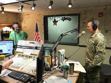 Col. Daniel Hibner, Commander of the Savannah District, U.S. Army Corps of Engineers, conducted a live, on-air interview with WTKS radio hosts Bill Edwards and Laura Anderson, on Sept. 6, 2018, in Savannah, Georgia. Hibner answered questions about the progress of the Savannah Harbor Expansion Project (SHEP), its economic impact for the nation, the timeline for completion of the project and the progress made to date. He also discussed other aspects of the Savannah District's widely varied mission including maintaining the deep water harbors in Savannah and Brunswick, Georgia; military construction at military bases in the region and the construction of the new headquarters of the Army's Cyber Command, located at Fort Gordon, in Augusta, Georgia. The SHEP will deepen the Savannah harbor from 42 to 47 feet which will allow larger container ships to enter or leave the harbor in a more timely manner and to enter and leave with heavier loads. (U.S. Army Corps of Engineers photo by Russell Wicke.)