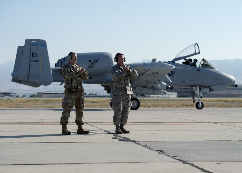 Army Brig. Gen. Michael J. Garshak, the adjutant general of Idaho and commander of the Idaho National Guard, shadows Air Force Staff Sgt. Jeremy Johnson, a 124th Aircraft Maintenance Squadron crew chief, while he prepares to launch an A-10 Thunderbolt II assigned to the 190th Fighter Squadron at Gowen Field, Boise, Idaho.