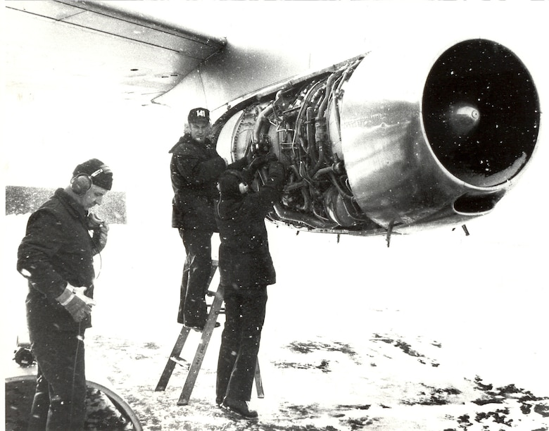 141st Air Refueling Wing maintainers work on a KC-135A in the snow December of 1976. (U.S. Air Force courtesy photo)