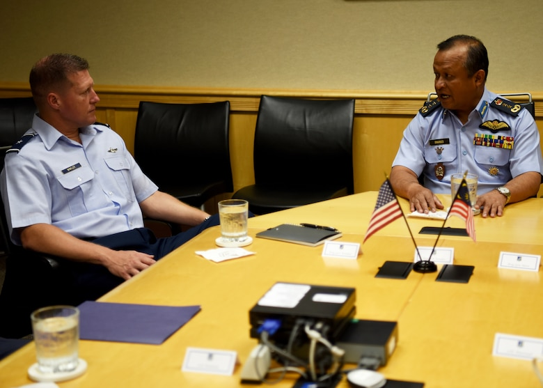 U.S. Air Force Brig. Gen. Michael Winkler, Pacific Air Forces Strategy, Plans, and Programs director, discusses the U.S. and Malaysian military relationship with Maj. Gen. Dato' Hj Mohd Faudzi bin Hj Ahmad, Royal Malaysian Air Force (RMAF), Assistant Chief of Staff for Operations and Strategy, on Joint Base Pearl Harbor-Hickam, Hawaii, Sept. 5, 2018.