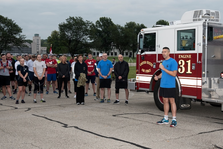 U.S. Air Force Col. Thomas P. Sherman, 88th Air Base Wing commander, makes welcoming comments prior to the start of the annual Run for the Fallen event at Wright-Patterson Air Force Base, Ohio, Sept. 11, 2018. Many members of the Wright-Patterson AFB community took part in the 5K run commemorating the 17th anniversary of the 9/11 terrorist attacks. (U.S. Air Force photo by Michelle Gigante)