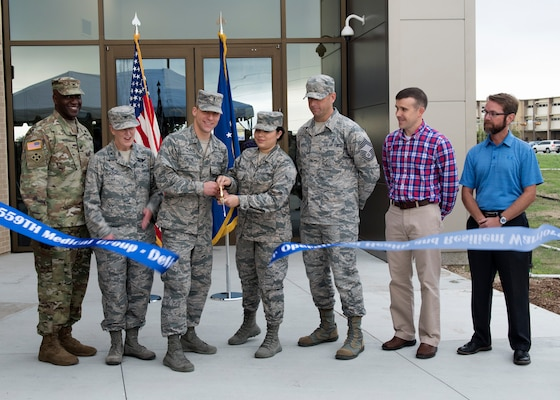 Members from the 559th Medical Group leadership along with U.S. Army Corps of Engineers, and civilian personnel cut the ribbon during the Sep. 13 opening ceremony for the new Reid Health Services Center on Joint Base San Antonio-Lackland, Texas. The new Reid Clinic incorporates functions from four buildings into one, consisting of 19 departments, and will serve approximately 86,000 patients per year. (U.S. Air Force photo by Staff Sgt. Kevin Iinuma)
