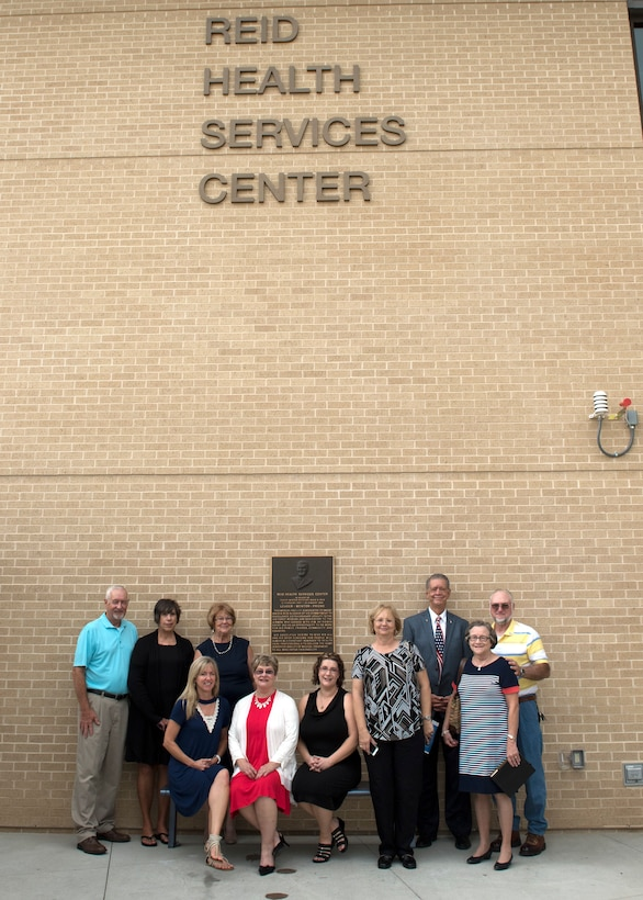 Family members of the late Senior Master Sgt. David B. Reid pose for a photo after the Sep. 13 ribbon cutting ceremony at the new Reid Health Services Center on Joint Base San Antonio-Lackland, Texas. The clinic was named in honor of Reid who was killed in a C-130 plane crash en route to Honduras in 1985. (U.S. Air Force photo by Staff Sgt. Kevin Iinuma)