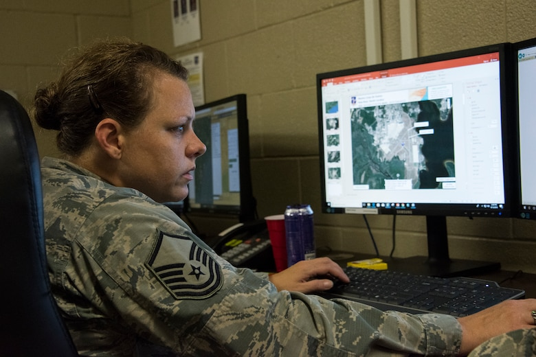 Master Sgt. Twila Costiloe, 188th Wing intelligence analyst, creates graphical information products in the 188th Unclassified Processing, Assessment, and Dissemination element at Ebbing Air National Guard Base, Ark., to support Hurricane Florence responders Sept. 13, 2013. The UPAD rapidly provides graphical information products requested by incident commanders located across the storm's path. (U.S. Air National Guard photo by Tech. Sgt. John E. Hillier)