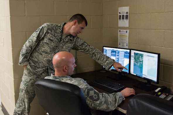188th Wing intelligence analysts create graphical information products in the 188th Unclassified Processing, Assessment, and Dissemination element at Ebbing Air National Guard Base, Ark., in support of Hurricane Florence responders, Sept. 13, 2013. The UPAD rapidly provides graphical information products requested by incident commanders located across the storm's path. (U.S. Air National Guard photo by Tech. Sgt. John E. Hillier)