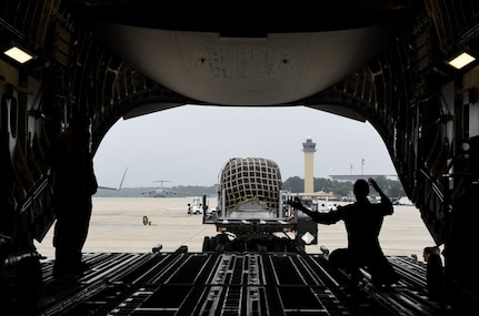 Staff Sgt. Andrea Jansen, a 16th Airlift Squadron loadmaster, guides a cargo truck into position from the ramp of a C-17 Globemaster III at Joint Base Andrews, Md., Sept. 11, 2018. In anticipation of Hurricane Florence, more than 20 aircraft were evacuated from Joint Base Charleston, S.C., to designated safe locations in order to continue their global airlift operations. Following the stop at Andrews, Jansen and her crew flew to Scott Air Force Base, Ill., for crew rest ahead of an international mission.