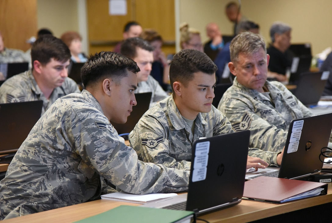 U.S. Air Force Airmen 1st Class Raymond Rowe and Jaran Daly, 460th Space Communications Squadron, Buckley Air Force Base, Colorado, and Staff Sgt. Derrick Shipley, 932nd Airlift Wing, Scott Air Force Base, Illinois, students, attend the 24th Air Force Enterprise Cyber Security Tools Training Course at Lott Hall at Keesler Air Force Base, Mississippi, Sept. 12, 2018. This is the first time the 690th Cyber Operations Group has held the course at Keesler. (U.S. Air Force photo by Kemberly Groue)