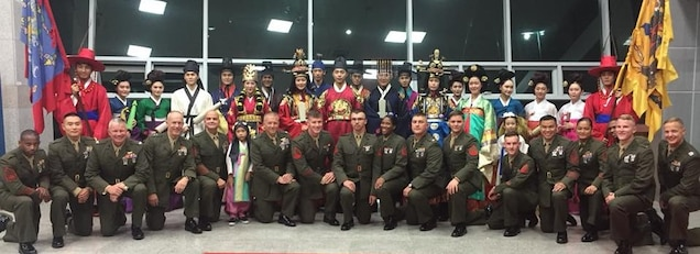 Camp Humphreys, Republic of Korea—U.S. Marine Forces Korea greets entertainers dressed in traditional Korean attire at the Ministry of Patriots and Veteran Affairs service member appreciation dinner in Songtan, Sept 12. The MPVA hosted the dinner to recognize the significance of United Nations Command and U.S. Forces Korea service members in defense of the Republic of Korea