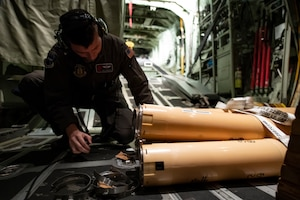 U.S. Air Force Reserve Master Sgt. Tom Barnaby, 53rd Weather Reconnaissance Squadron loadmaster, prepares Airborne Expendable Bathythermographs  for a mission into Hurricane Florence Sept. 12, 2018. The buoys are released from a flare launch tube during flight to measure oceanic conditions, which provides information for forecasts. (U.S. Air Force Photo by Tech. Sgt. Chris Hibben)