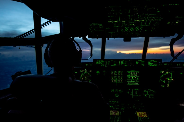 U.S. Air Force Reserve Lt. Col. Jerry Rutland, 53rd Weather Reconnaissance Squadron pilot, flies a WC-130J into the early morning sunrise as they approach Hurricane Florence Sept. 12, 2018. The U.S. Air Force Reserve Hurricane Hunters are conducting a reconnaissance mission to provide critical and timely weather data for the National Hurricane Center to assist in providing up-to-date and accurate information for storm forecasts. (U.S. Air Force photo by Tech. Sgt. Chris Hibben)