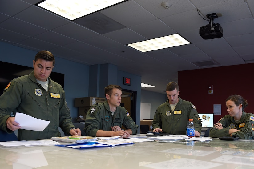 apt. Sean Lucas, center right, 16th Airlift Squadron pilot, delivers a pre-flight mission brief to crew members Sept. 11, 2018, at Joint Base Charleston, S.C.