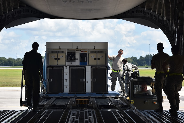 Airmen assigned to the 437th Aerial Port Squadron and 16th Airlift Squadron load a portable lavatory onto a C-17 Globemaster III at Joint Base Charleston, S.C., Sept. 11, 2018.