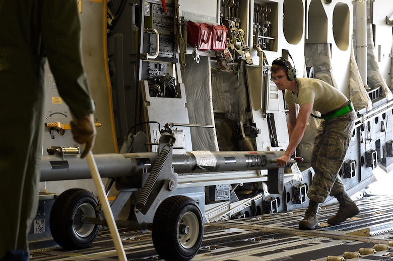 Staff Sgt. Donald Kirby, a 437th Aircraft Maintenance Squadron aerospace maintainer, moves a tow bar into its storage position on a C-17 Globemaster III at Joint Base Charleston, S.C., Sept. 11, 2018.