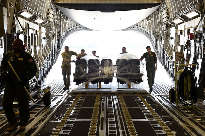 Airmen assigned to the 437th Airlift Wing load airplane seats onto a C-17 Globemaster III at Joint Base Charleston, S.C., Sept. 11, 2018.