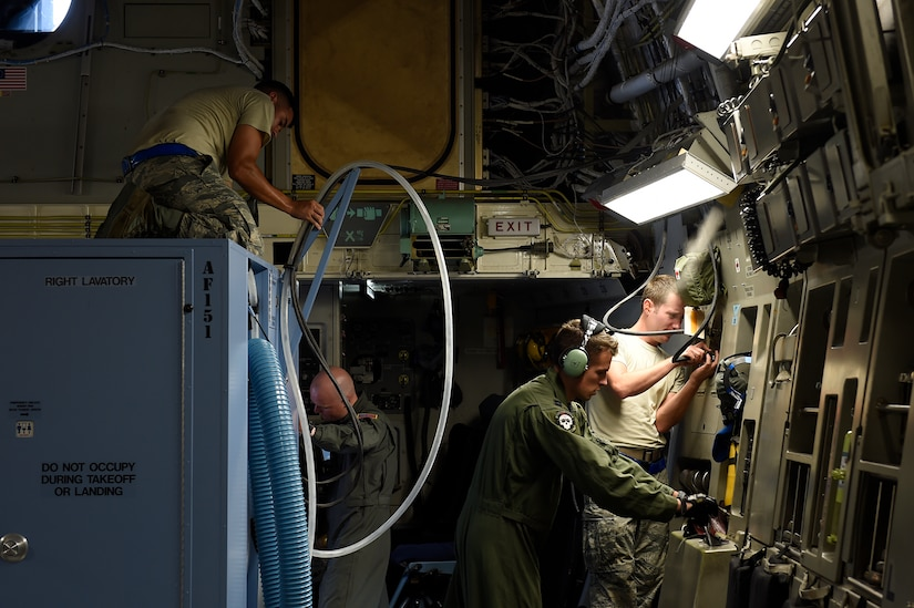 Airmen assigned to the 437th Aircraft Maintenance Squadron and 16th Airlift Squadron perform pre-flight operations on a C-17 Globemaster III at Joint Base Charleston, S.C., Sept. 11, 2018.