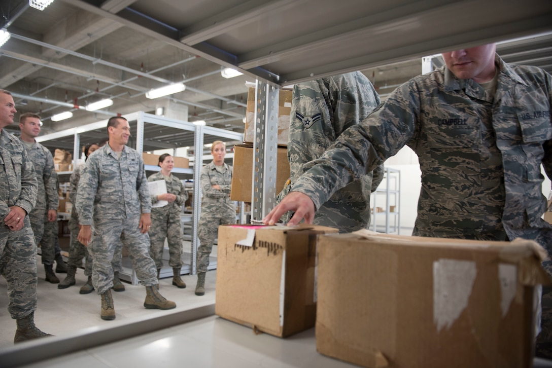 A member of the 919th Special Operations Logistics Readiness Squadron from Duke Field, Fla., checks a package as part of training with the 18th Logistics Readiness Squadron Sept. 12, 2018, at Kadena Air Base, Japan. Each base within the Air Force has its own tempo. Smaller units with fewer operational requirements may train with larger, busier units to prepare for potential deployments or increases in their home-stations demands.