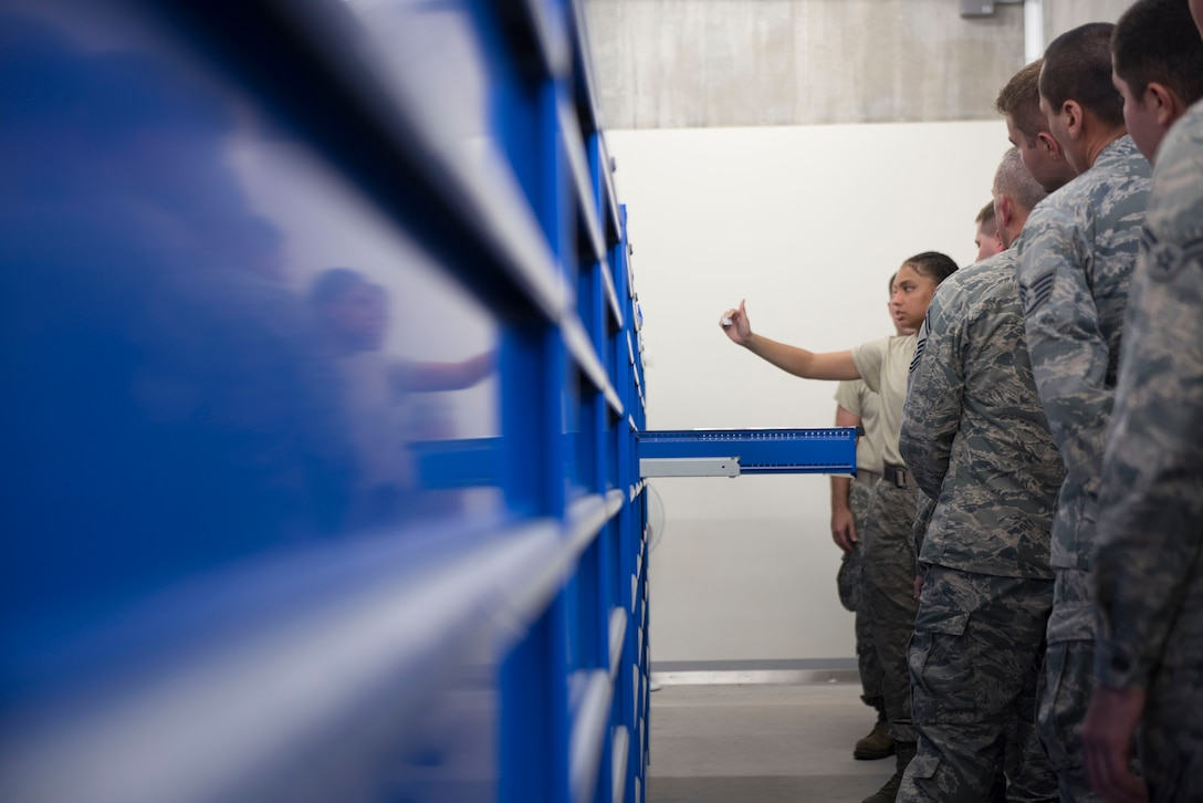 U.S. Air Force Senior Airman Serah Lewis, 18th Logistics Readiness Squadron central storage journeyman, leads training for members of the 919th Special Operations Logistics Readiness Squadron from Duke Field, Fla., Sept. 12, 2018, at Kadena Air Base, Japan. Airmen train consistently to ensure all members are educated and ready to perform their missions.