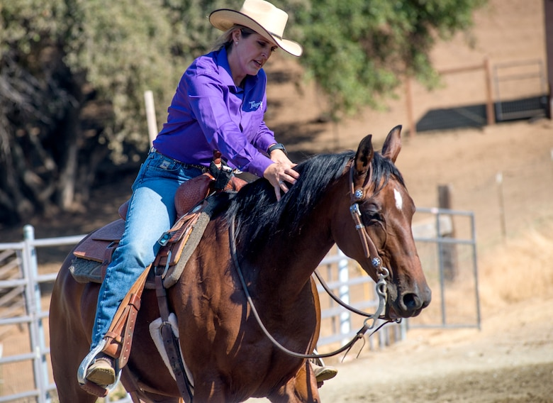 "Cutting is a western-style equestrian competition in which a horse and rider work as a team before a judge or panel of judges to demonstrate the horse's athleticism and ability to handle cattle during a ​2 1⁄2 minute performance, called a ""run."" Each contestant is assisted by four helpers: two are designated as turnback help to keep cattle from running off to the back of the arena, and the other two are designated as herd holders to keep the cattle bunched together and prevent potential strays from escaping into the work area."