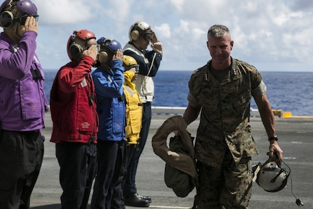 Lt. Gen. Eric Smith, III Marine Expeditionary Force commanding general, boards the amphibious assault ship USS Wasp (LHD 1), while underway off the coast of Okinawa, Japan, Aug. 27, 2018.