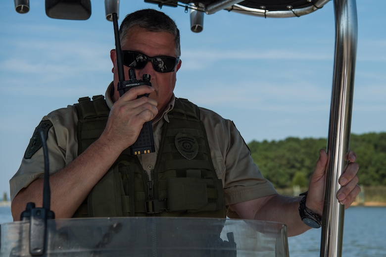 Christopher Griffin, 733rd Security Forces Squadron game warden, calls in the start of the patrol the police station at Joint Base Langley-Eustis, Virginia, Aug. 30, 2018.