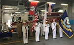 DLA Distribution Yokosuka, Japan's, commanding officer Navy Cmdr. Allen Rivera (back row, fourth from left) salutes during Command Fleet Activity, Yokosuka Remembrance Ceremony's presentation of the colors on Sept. 11.