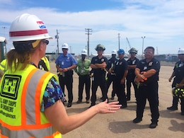 U.S. Army Corps of Engineers Project Manager Brenda Barber speaks with local officials, first responders and representatives from the U.S. Coast Guard and the Port of Galveston as part of a tour of the STURGIS June 9, 2015 in Galveston, Texas soon after the vessel arrived there for its final decommissioning. The U.S. Army Corps of Engineers coordinated closely with local partners throughout the project, especially regarding safety, and during the tour U.S. Army Corps of Engineers personnel explained the process of how the decommissioning of the barge would be completed, provided an overview of the site and reviewed safety procedures.