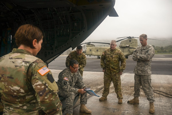 Chief Warrant Officer 4 Patrick Donohue, a CH-47 Chinook pilot with the Eastern Army Aviation Training Site (EAATS) briefs his crew before takeoff Sept. 13, 2018, from Muir Army Airfield at Fort Indiantown Gap, Pennsylvania. Approximately 25 Pennsylvania Guard members in two Chinooks and two UH-56 Black Hawk helicopters are bound for South Carolina in support of Hurricane Florence recovery efforts.