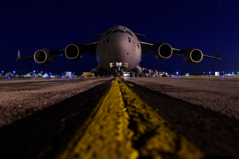 Airmen assigned to the 437th Aircraft Maintenance Squadron change a tire on a C-17 Globemaster III Sept. 13, 2018, at Scott Air Force Base, Ill. 437th AMXS maintainers serviced more than 10 aircraft that were evacuated from Joint Base Charleston, S.C., to Scott AFB ahead of Hurricane Florence. In all, more than 20 C-17s and supporting personnel were evacuated to three designated safe locations, enabling them to continue their global airlift operations.