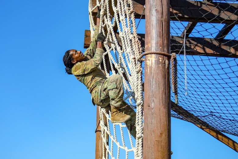 Senior Airman Rosa Young, 891st Missile Security Forces Squadron member, climbs a net during an obstacle course Aug. 29, 2018, at Fort Harrison, Mont. Airmen are trained to adhere to the highest standards of personal reliability, dedication and performance. (U.S. Air Force photo by Airman 1st Class Tristan Truesdell)