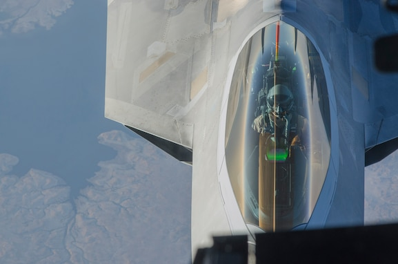 An F-22 Raptor pilot from the 94th Expeditionary Fighter Squadron, Al Dhafra Air Base, United Arab Emirates, flies behind a 908th Expeditionary Air Refueling Squadron KC-10 Extender over Southwest Asia, Sept. 12, 2018. The F-22 possesses a sophisticated sensor suite allowing the pilot to track, identify, shoot and kill air-to-air threats before being detected. (U.S. Air Force photo by Staff Sgt. Ross A. Whitley)