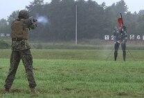 Firing a pepperball handgun.