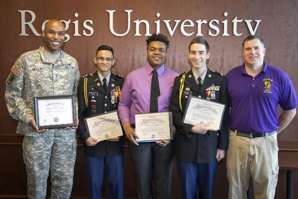 ​U.S. Army Chief Warrant Officer 2 Robert Heflin, left, Colorado Army National Guard telecommunications manager, and Junior Reserve Officer Training Corps students and managers from Denver North High School display their certificates of appreciation from the U.S. Air Force Association 2017 CyberPatriot, National Youth Cyber Defense competition.