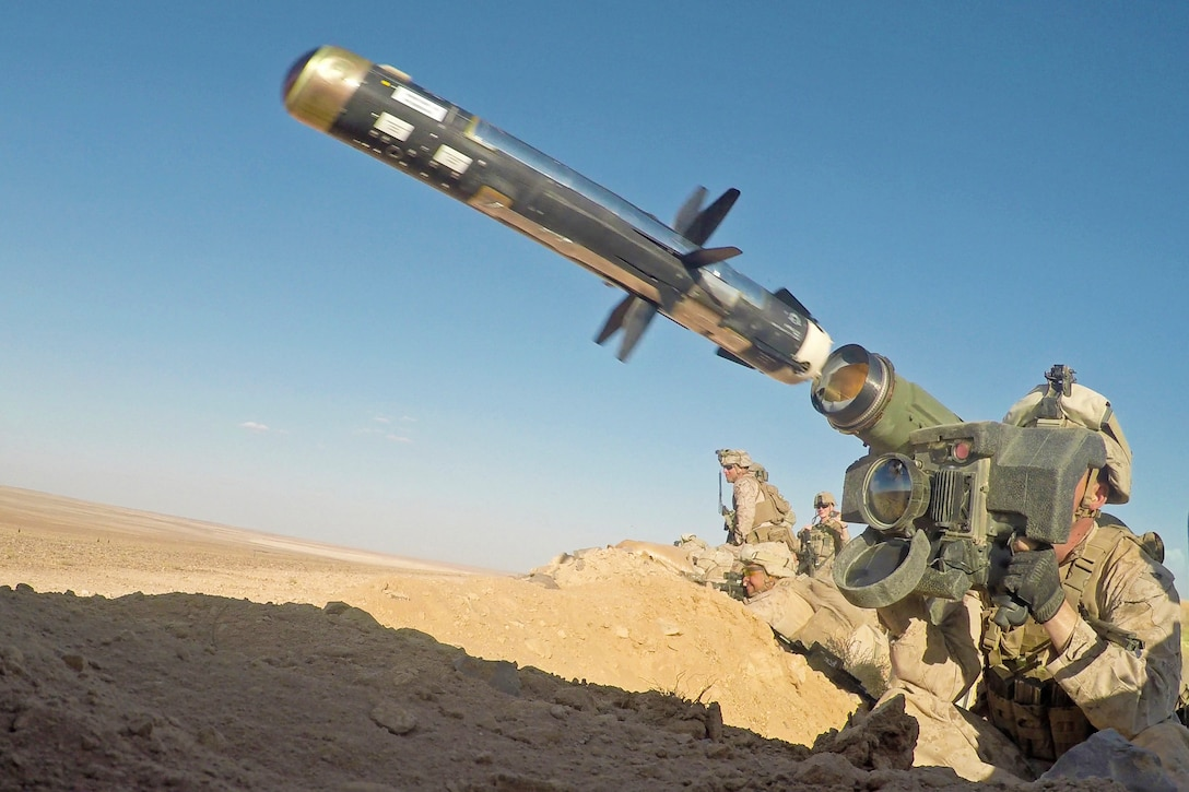A Marine shoulder-fires an anti-tank missile.