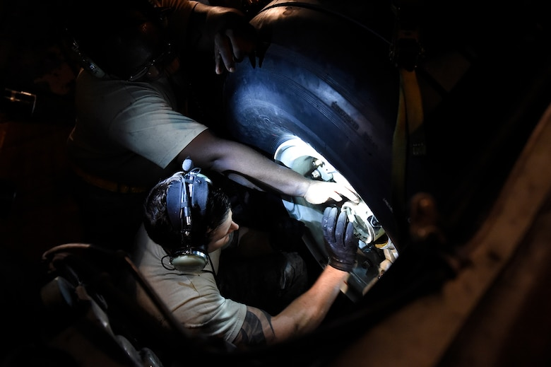 Staff Sgt. Coleman Younger, a 437th Aircraft Maintenance Squadron crew chief, performs a tire change on a C-17 Globemaster III Sept. 13, 2018, at Scott Air Force Base, Ill. 437 AMXS maintainers serviced more than 10 aircraft that were evacuated from Joint Base Charleston, S.C., to Scott AFB ahead of Hurricane Florence. In all, more than 20 C-17s and supporting personnel were evacuated to designated safe locations, enabling them to continue their global airlift operations.