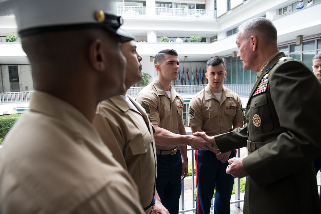 Marine Corps Gen. Joe Dunford, chairman of the Joint Chiefs of Staff, meets with Marine security guards.