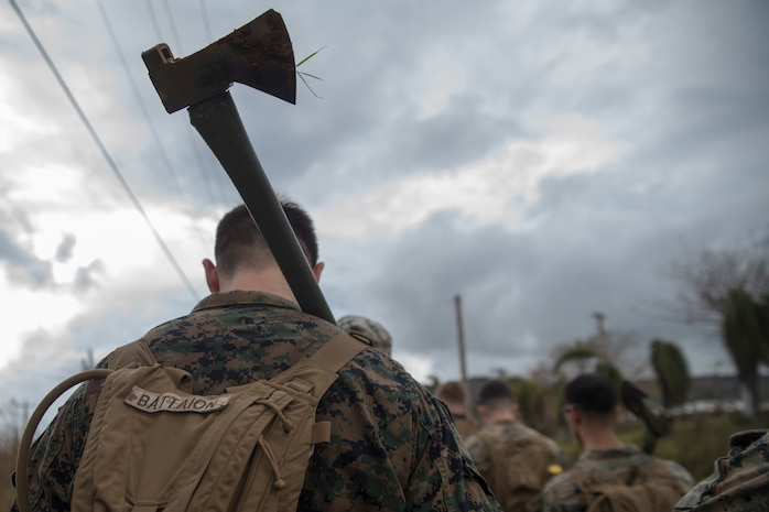 Marines and Sailors from Battalion Landing Team, 2nd Battalion, 5th Marines, and Combat Logistics Battalion 31, prepare to clean up debris after Typhoon Mangkhut during typhoon relief efforts in Rota, Commonwealth of the Northern Mariana Islands, Sept. 13, 2018. Service members from the Indo-Pacific Command are providing Department of Defense support to the Federal Emergency Management Agency, and working with Guam and Commonwealth of the Northern Mariana civil and local officials for Typhoon Mangkhut recovery efforts. The 31st Marine Expeditionary Unit, the Marine Corps' only continuously forward-deployed MEU, provides a flexible force ready to perform a wide-range of military operations.