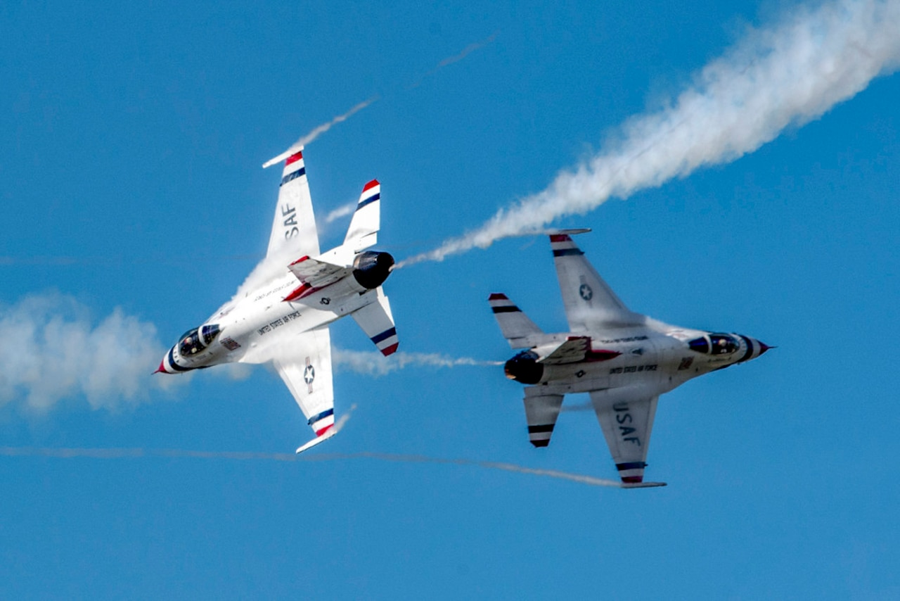Jets pass each other in the air.