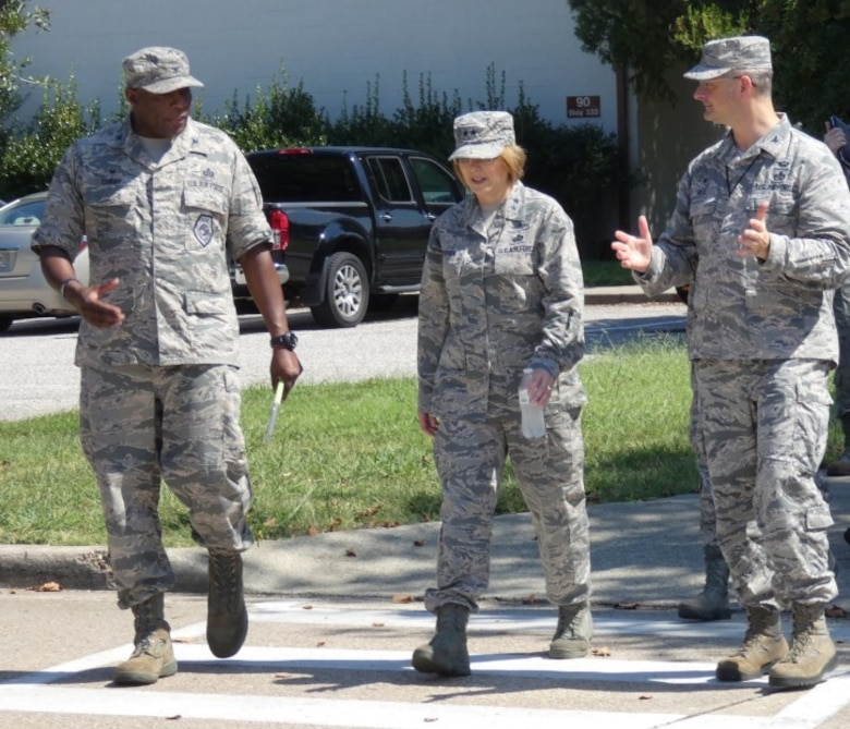 U.S. Air Force Maj. Gen. Mary F. O'Brien, commander, Twenty-Fifth Air Force, confers with Col. Jonathan C. Rice, IV, commander, 363d Intelligence, Surveillance and Reconnaissance Wing (ISRW) (right) and Col. Mack W. Curry, II, commander, 363 ISR Group (left), about current ISR processes and future opportunities during a visit to the 363 ISRW at Joint Base Langley-Eustis, Virginia, Sept 4, 2018.
